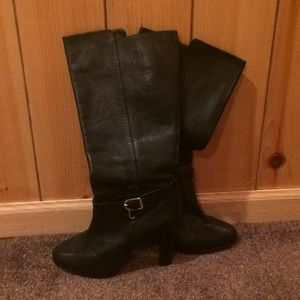 Black high heel leather boots